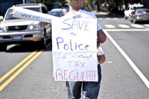 A marijuana legalization advocate marches down Market Street on Saturday. Photo: Joshua Albert